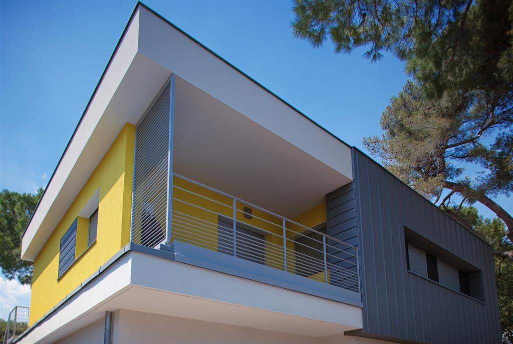 maison moderne jaune